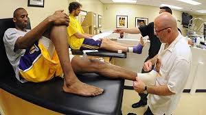 basketballer receiving treatment on foot
